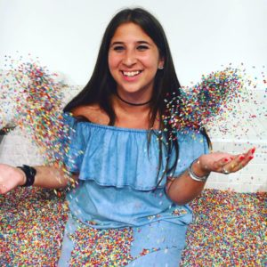 Tessa in a pool of sprinkles